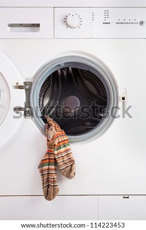 Washer machine and men's socks - stock photo