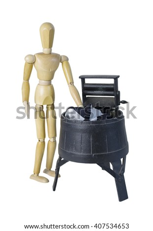Washing Clothes in a Vintage Washing Machine with Squeezing Rollers - path included - stock photo