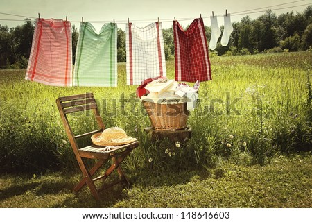 Washing day with laundry on clothesline - stock photo