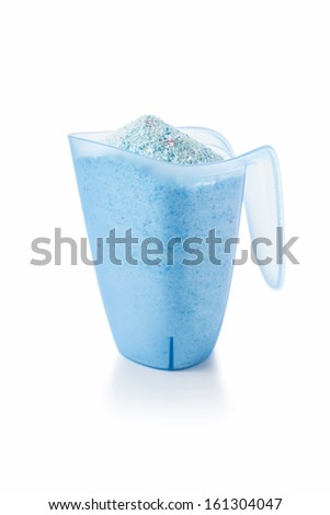 Washing Detergent Powder in a Measuring Cup Isolated on White Background - stock photo