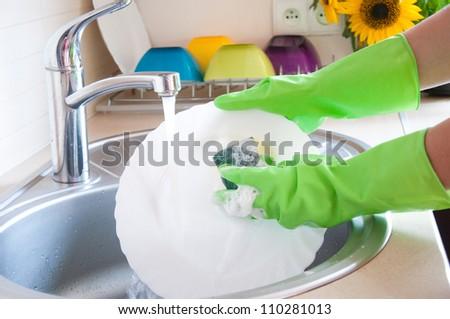 Washing dishes, housework - stock photo