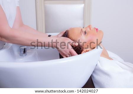 Washing hair in barbershop - stock photo