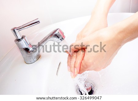 Washing hands for information background this image main focus on hands - stock photo