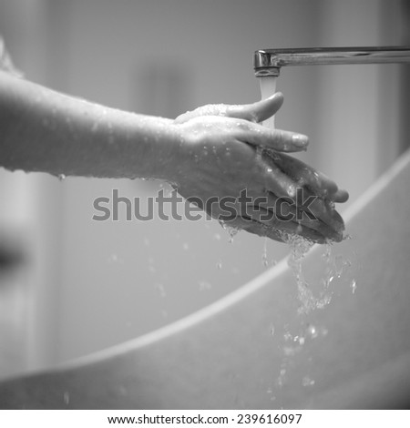 Washing hands, monochrome - stock photo