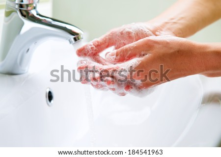 Washing Hands with soap. Woman Cleaning Hands in a bathroom. Hygiene  - stock photo