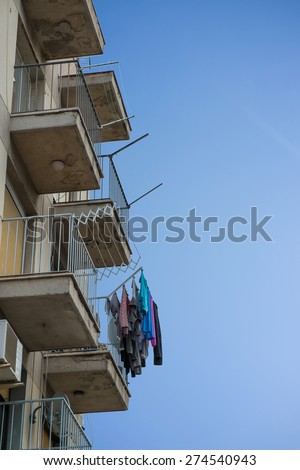 Washing hanging from the balconies of a building - stock photo