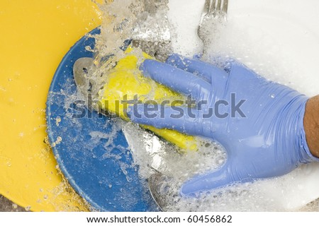 Washing kitchen ware on the silk - stock photo