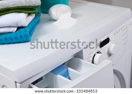 Washing machine and laundry powder for washing. - stock photo
