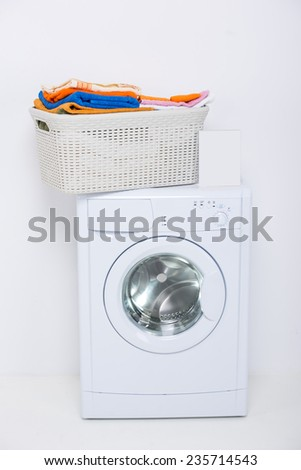 Washing machine, is isolated on white background, cleaning agents and clothes. - stock photo