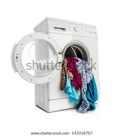 Washing machine with clean linen on a white background - stock photo