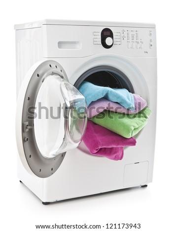 Washing machine with laundry isolated on white - stock photo