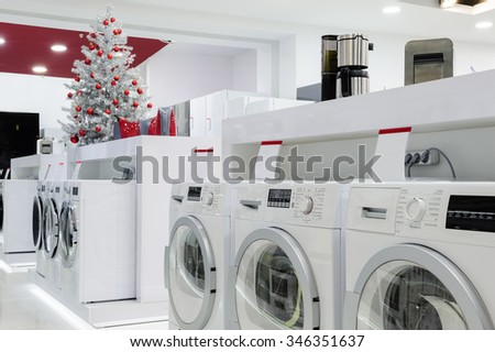 Washing machines, refrigerators and other home related appliance or equipment in the retail store at Christmas - stock photo