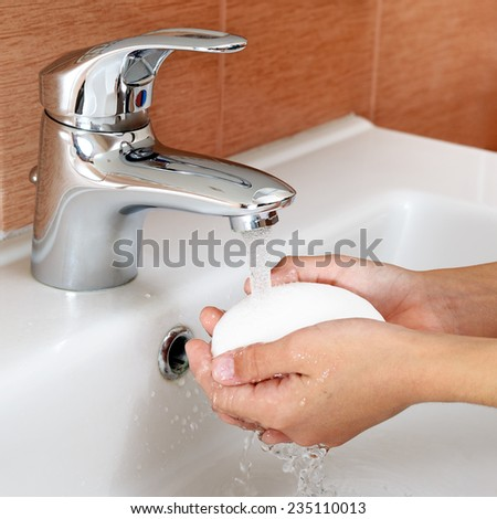 Washing of hands with soap - stock photo