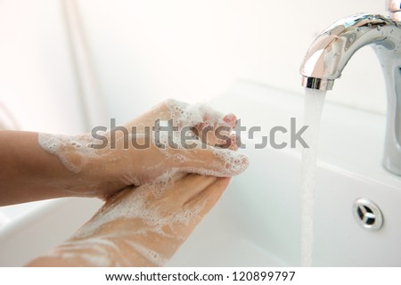 Washing of hands with soap under running water. - stock photo