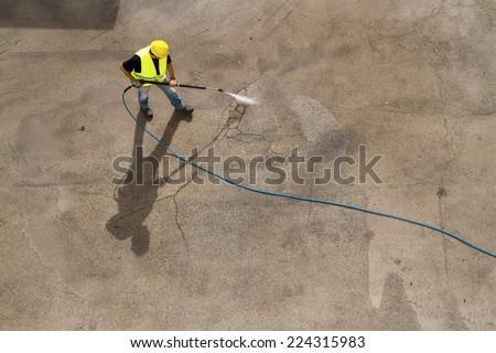 washing pavement - stock photo