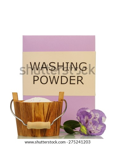 Washing powder in wooden basket and flower isolated on white - stock photo