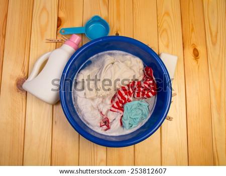 Washing the laundry manual in bucket - stock photo