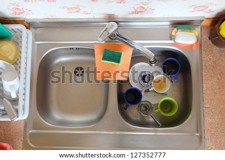 washing-up bowl in kitchen indoor cup - stock photo
