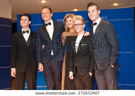 WASHINGTON APRIL 25 â?? Arianna Huffington poses with her guests at the White House Correspondentsâ?? Association Dinner April 25, 2015 in Washington, DC  - stock photo