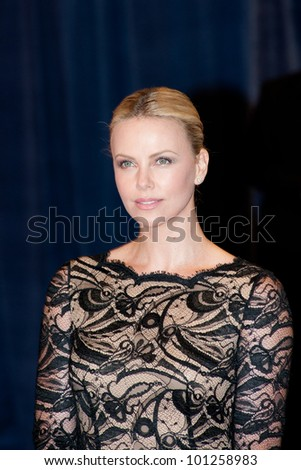 WASHINGTON � APRIL 28: Charlize Theron arrives at the White House Correspondents Dinner April 28, 2012 in Washington, D.C. - stock photo