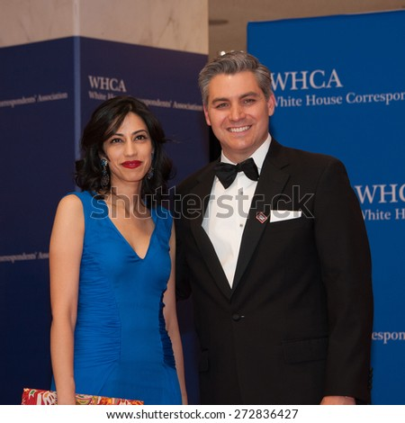WASHINGTON APRIL 25 - Huma Abedin and guest arrive at the White House Correspondents' Association Dinner April 25, 2015 in Washington, DC  - stock photo