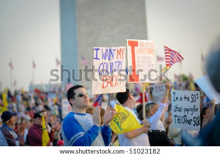 WASHINGTON -- APRIL 15: Participants at the tax day tea party rally at the Washington Monument on April 15, 2010 in Washington, D.C. - stock photo