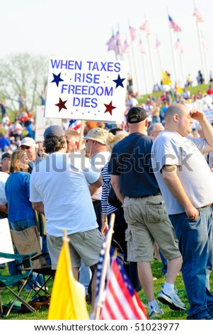 WASHINGTON - APRIL 15: Protesters at the tax day tea party rally at the Washington monument on April 15, 2010 in Washington, D.C. - stock photo
