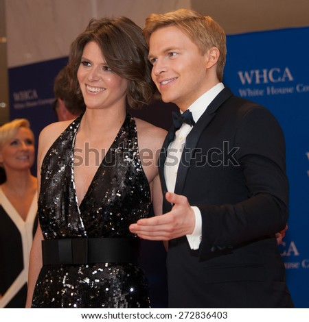 WASHINGTON APRIL 25 � Ronan Farrow and guest arrive at the White House Correspondents� Association Dinner April 25, 2015 in Washington, DC  - stock photo