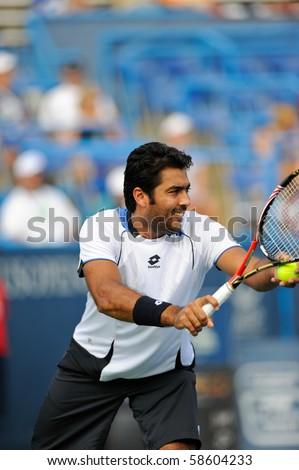 WASHINGTON - AUGUST 6: Aisam-Ul-Haq Qureshi (PAK) with Rohan Bopanna (IND) defeat Bob and Mike Bryan (USA) at the Legg Mason Tennis Classic on August 6, 2010 in Washington. - stock photo