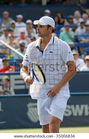 WASHINGTON- AUGUST 9: Andy Roddick (USA) takes a breather in the championship match of the Legg Mason Tennis Classic August 9, 2009 in Washington. Roddick was defeated by Juan Martin Del Potro (ARG). - stock photo