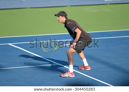 WASHINGTON - AUGUST 8: Bob and Mike Bryan (USA) defeat the doubles team of Bopanna and Mergea  (not pictured) in the semifinals at the Citi Open tennis tournament on August 8, 2015 in Washington DC  - stock photo