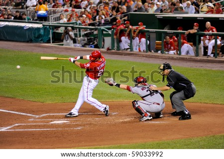 WASHINGTON - AUGUST 14: Ian Kennedy of the Washington Nationals swings at a pitch in the Nationals' home game against the Arizona Diamondbacks on August 14, 2010 in Washington. - stock photo