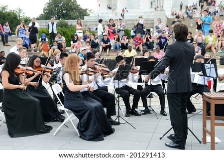 WASHINGTON - AUGUST 2, 2013: Irvine Classical Players Seraphim Symphony, on tour from Irvine, CA.,  performed in front of the Lincoln Memorial for crowds of tourists.  - stock photo