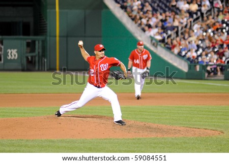 WASHINGTON - AUGUST 14: Joel Peralta of the Washington Nationals pitches in the Nationals' home game against the Arizona Diamondbacks on August 14, 2010 in Washington. - stock photo
