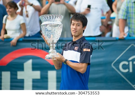 WASHINGTON  AUGUST 9: Kei Nishikori (JPN) with his trophy after winning the men's finals title at the Citi Open tennis tournament on August 9, 2015 in Washington DC - stock photo