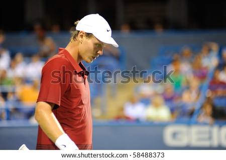 WASHINGTON - AUGUST 4: Wimbledon finalist Tomas Berdych (CZE) in his second round match against Dmitry Tursunov (RUS) at the Legg Mason Tennis Classic on August 4, 2010 in Washington. Berdych won. - stock photo