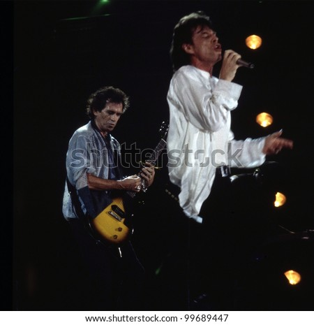 WASHINGTON, D.C. - AUG 4: Mick Jagger, at right,  and Keith Richards play during the Rolling Stones' Voodoo Lounge Tour in Washington, D.C., on Thursday, August 4, 1994. - stock photo