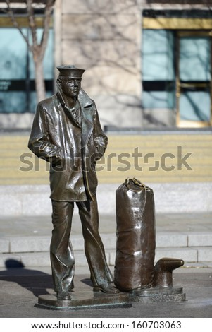 WASHINGTON, D.C. - JAN 20, 2013: Lone Sailor Statue at Navy Memorial which honors those who served  in the Navy, Marine Corps, Coast Guard, and the Merchant Marine.  - stock photo