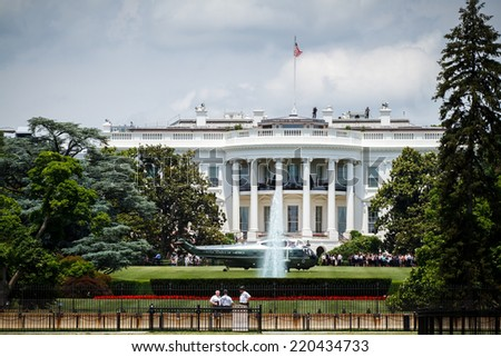 WASHINGTON, D.C. - JUNE 11, 2014: Sikorsky VH-3D Sea King designated as Marine One when carrying the President of the United States lands in front of the White House. - stock photo