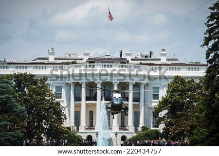 WASHINGTON, D.C. - JUNE 11, 2014: Sikorsky VH-3D Sea King designated as Marine One when carrying the President of the United States takes off from the White House. - stock photo