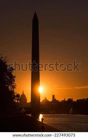 Washington D.C. - Sunrise at Lincoln Memorial with silhouettes of Capitol Building and Washington Monument  - stock photo
