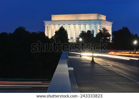 Washington DC - Abraham Lincoln Memorial from Arlington Memorial Bridge with car lights trails at night - stock photo