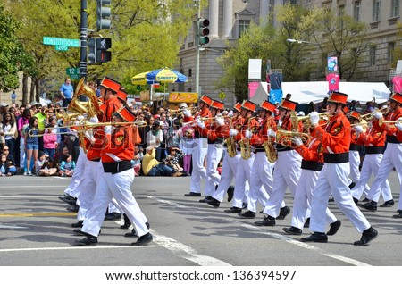 WASHINGTON, DC - APRIL 13: Cherry Blossom Parade on April 13, 2013 in Washington DC,USA.The parade is a spring celebration in Washington D.C.and people from all over the world come to watch the event - stock photo