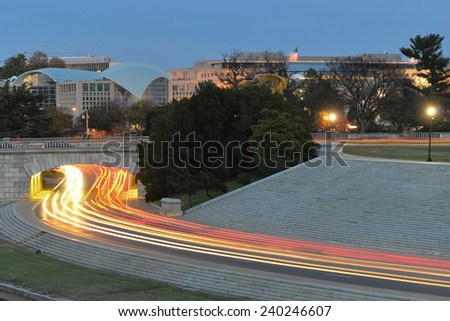 Washington DC at night - Car lights trails into to tunnel on Ohio Drive NW - stock photo