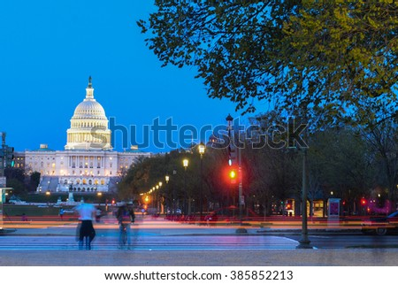 Washington DC at night - US Capitol Building with car lights trails foreground  - stock photo