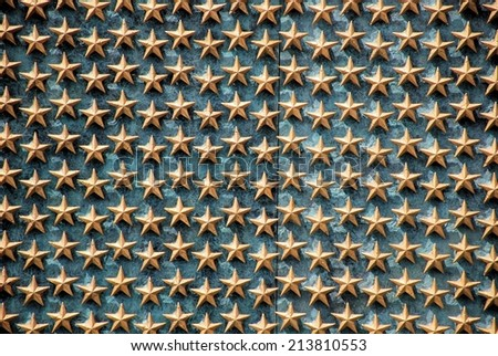 WASHINGTON, DC - AUGUST 24, 2014:  The Freedom Wall at the WWII memorial in Washington, DC.  Each star represents 100 Americans that died or remain missing during WWII. - stock photo