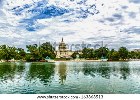 WASHINGTON, DC - AUGUST 13: US Capitol on August 13 2013. US Capitol, meeting place of the Senate and the House of Representatives, is one of the most recognizable historic buildings in Washington DC - stock photo