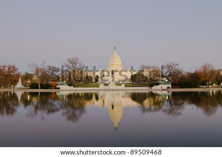 Washington DC, Capitol Building in dusk with reflection on the pool - stock photo