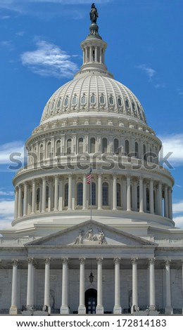 Washington DC Capitol detail with waving american flag - stock photo