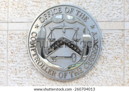 WASHINGTON, DC - DECEMBER 26: Seal of the Office of the Comptroller of the Currency in downtown Washington, DC on December 26, 2014. - stock photo